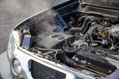 Car engine over heat with no water in radiator and cooling syste. M. Overheated car machine Broken down with smoking, overheating engine on the road. Automotive royalty free stock photography