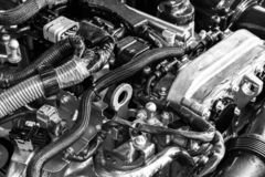Car engine. Car engine part. Close-up image of an internal combustion engine. Engine detailing in a new car. Car detailing. Black. And white stock image