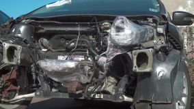 Car without engine after a serious accident. Recovery of a car crashed in an accident. Complete engine replacement stock video footage