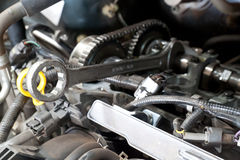 Car engine and spanner. Stock Photo