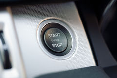 Car engine start and stop button on a hybrid car stock images