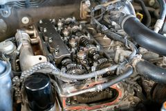 Car engine twins head camshaft system with Roller timing chain. Close up of parts in a car engine twins camshaft system with Roller timing chain. - Overhaul stock photos