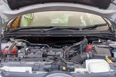 Car engine under the open hood Royalty Free Stock Photos