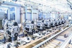 Car engines at conveyor line Stock Photos