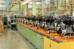 Car engines on factory assembly line. Royalty Free Stock Photos