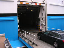 Car Entering Ferry. A car entering the ferry car deck Royalty Free Stock Image