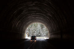 Car entering in a tunnel with forest in background with snow Royalty Free Stock Photography