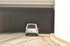 Car Entering a Tunnel. White car entering a tunnel and smog Stock Photos