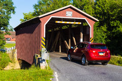 Car Enters Landis Valley Covered Bridge in Lancaster County Royalty Free Stock Image