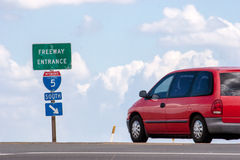 Car at the Entrance of a Freeway. A red car about to drive onto interstate 5 south Stock Images