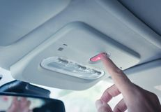 Man`s hand touching an ecall button. Car equiped with an eCall system. European initiative intended to bring rapid assistance to motorists involved in a royalty free stock photos