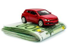 Car on euro notes. A car stands on euro banknotes. cost of purchasing a car, petrol, insurance and other car costs stock images