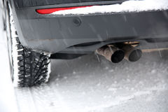 Car Exhaust Pipe. In Snow Royalty Free Stock Photo
