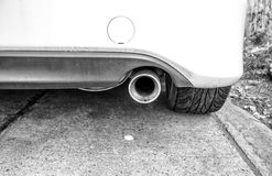 Car Exhaust Pipe. Black and white modern car exhaust pipe Royalty Free Stock Photography