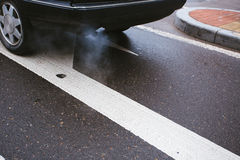 Car exhaust pipe. Close up of a car exhaust pipe on the road Stock Photography