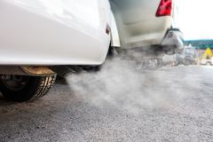 Car exhaust pipe comes out strongly of smoke. Air pollution concept Royalty Free Stock Photography