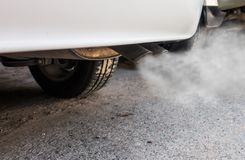 Car exhaust pipe comes out strongly of smoke. Air pollution concept Stock Photography