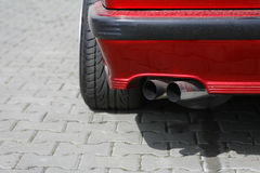 Car exhaust pipe. Car double exhaust pipe from a red sport car Stock Image