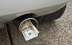Car, exhaust pipe and money Royalty Free Stock Photography