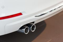 Car exhaust pipe. White luxury car exhaust pipe Stock Image