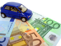 Car expenses. Blue car over euro notes isolated Stock Image