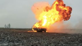 Car explosion in the field. Car on fire. Slow motion