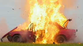 Car explosion side view. car on fire. Slow motion