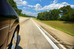 Car on the expressway on a sunny day Stock Images