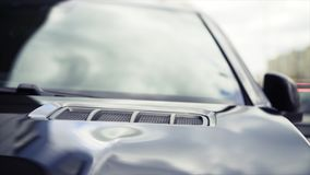 Car exterior background detail. Stock. Air intake in hood. Air intakes on the car hood.  stock photography