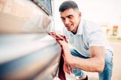 Car exterior polishing on carwash station Stock Photo