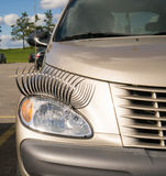 Car with Eyelashes Royalty Free Stock Images