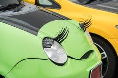 Car with eyelashes on headlightsas feminine symbol Stock Photos