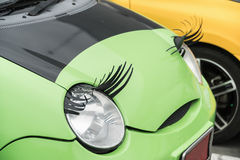 Car with eyelashes on headlightsas feminine symbol Stock Photography