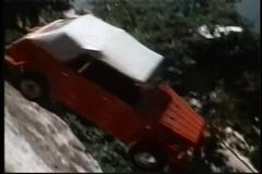 Car falling off cliff stock video footage