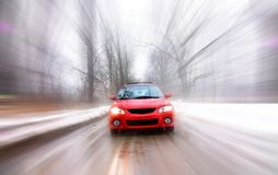 Car In Fast Motion. Red color sports car moving in fast motion Stock Photo