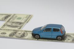 Car and fee. A toy car and several bucks of US Dollar on white background Stock Images