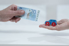 Car fee. Close-up of man's hand holding the car fee stock photography