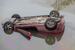 The car fell into the water. And capsized stock photography