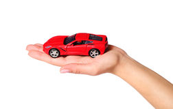 Car in female hand isolated on white background Royalty Free Stock Photos