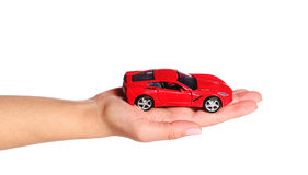 Car in female hand isolated on white Royalty Free Stock Photography