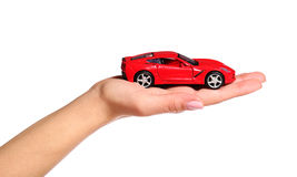 Car in female hand isolated on white Royalty Free Stock Images