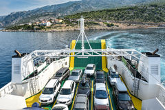 Car Ferry Boat with rows of cars is leaving the port. Stock Image