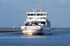 Car Ferry. A car ferry moves into the harbor Royalty Free Stock Image