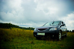 Car in field. Off road adventure - city car in a green field Stock Photo