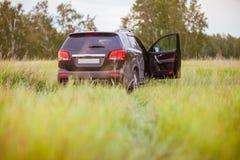 Car in field. Black car in an open field Stock Photo