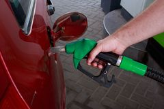 Car fill with gasoline. At a gas station royalty free stock photography