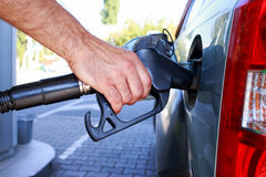 Car fill with gasoline. At a gas station Stock Images