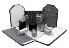 Car filters. Composition of various car filters - oil, air, fuel and cabin filters Royalty Free Stock Photography
