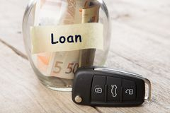 Car finance concept - money glass with word Loan, car key. Rent auto rental sale security driving road insure buy alarm vehicle service business open system stock images