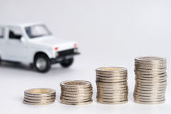 Car finance money stack. With white background Royalty Free Stock Images